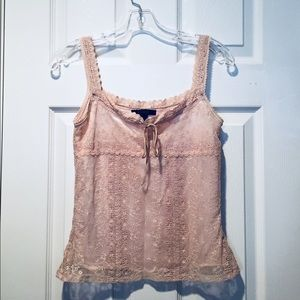 Sleeveless lace-covered top.